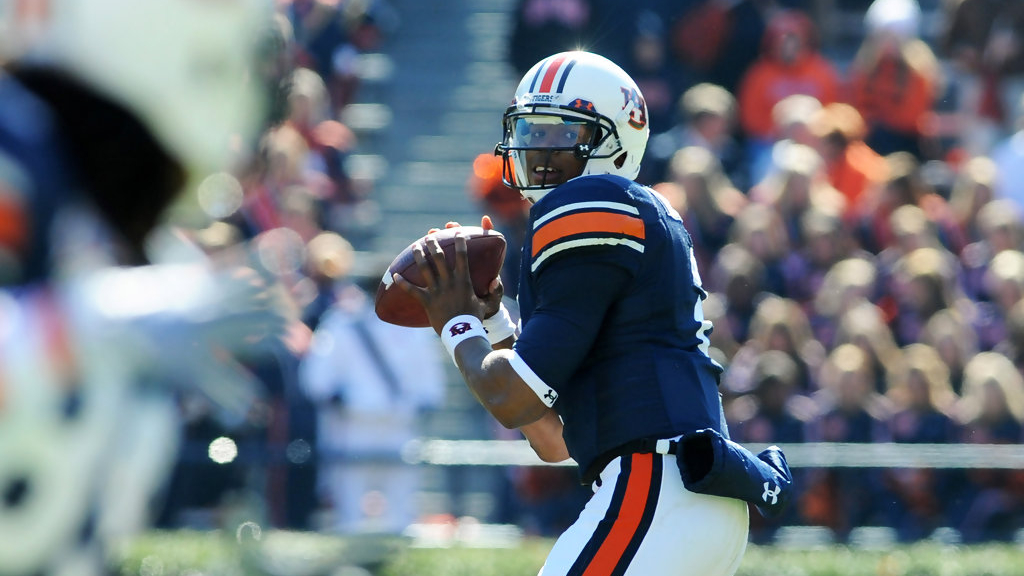 Auburn Tigers quarterback Cam Newton sets to throw a pass against the Chattanooga Mocs