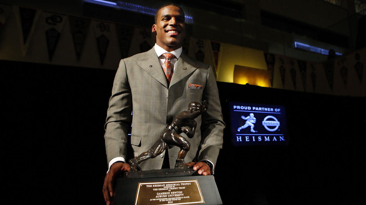 Auburn Tigers quarterback Cam Newton poses with the 2010 Heisman Memorial Trophy Award at the New York Marriott Marquis
