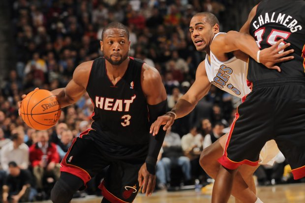 Miami Heat star Dwyane Wade drives to the basket against the Denver Nuggets