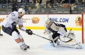 Former Edmonton Oilers forward Dustin Penner attempts a shot on Pekka Rinne against the Nashville Predators