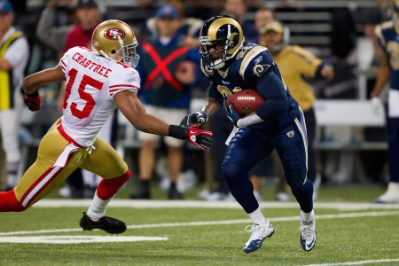 Oshiomogho Atogwe is seen here as a member of the St. Louis Rams intercepting a San Francisco 49ers pass (Getty Images)