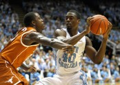 Harrison Barnes is seen here attempting to be blocked by Texas Longhorns J'Covan Brown (Getty Images)