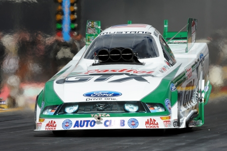 Castrol GTX Funny Car pilot Mike Neff racing down the track