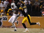 Lawrence Timmons trying to tackle New York Jets wide receiver Braylon Edwards (Getty Images)