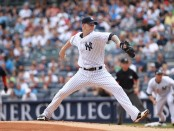 New York Yankees pitcher A.J. Burnett pitching against the Boston Red Sox