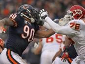 Chicago Bears defensive end Julius Peppers rushes Branden Albert against the Kansas City Chiefs