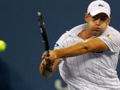Tennis star Andy Roddick returns the ball against Juan Martin Del Potro in his final match