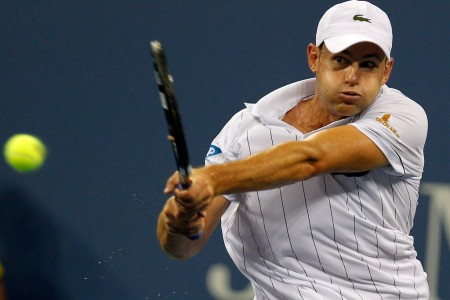 Tennis star Andy Roddick returns the ball against Juan Martin Del Potro in his final match