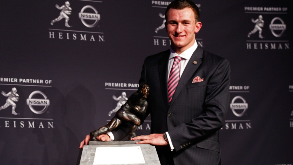 Texas A&M Aggies quarterback Johnny Manziel poses with the Heisman Trophy after being named the 78th Heisman Memorial Trophy Award winner at a press conference