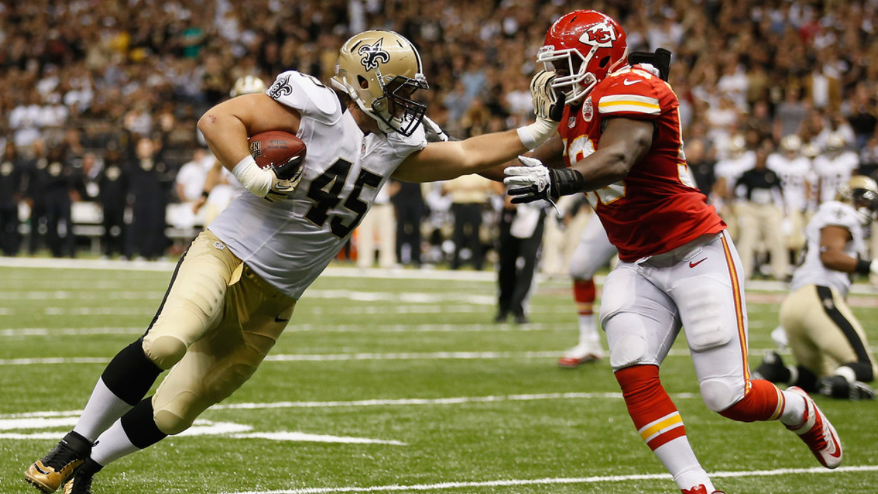 Former Kansas City Chiefs linebacker Jovan Blecher attempts to tackle Jed Collins against the New Orleans Saints