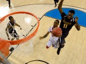 Former Louisville Cardinals guard Russ Smith drives to the basket as Cleanthony Early attempts to block his shot against the Wichita State Shockers