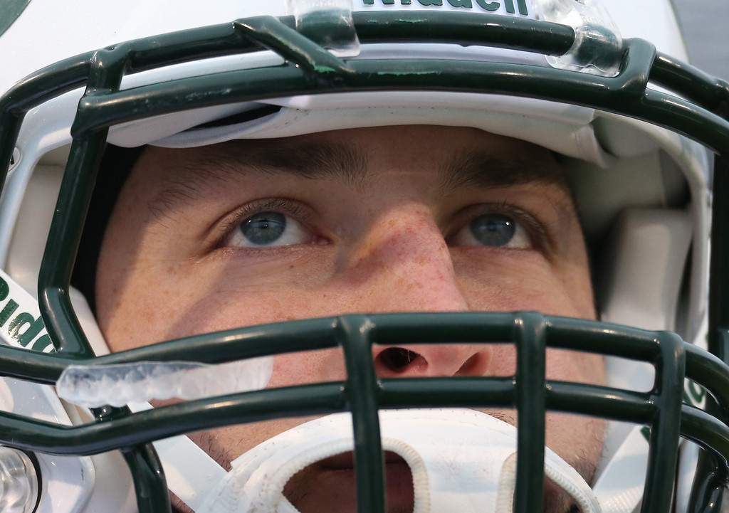 New York Jets quarterback Tim Tebow looks on from the sidelines against the Buffalo Bills