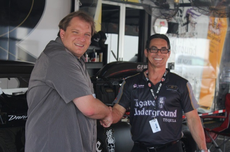 Pro Mod racer Danny Rowe shaking hands with Publisher Anthony Caruso III