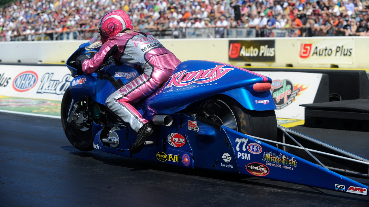 Kandy Pro Stock Motorcycle rider Angie Smith racing on Sunday at the Auto Plus NHRA New England Nationals