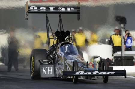Top Fuel Dragster pilot Shawn Langdon is racing to the final round in Pomona