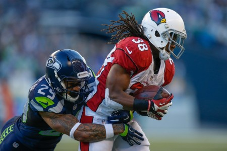 Earl Thomas tackling Arizona Cardinals running back Andre Ellington (Getty Images)