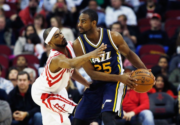 Former Utah Jazz player Elliot Williams is being defended by Houston Rockets' Corey Brewer
