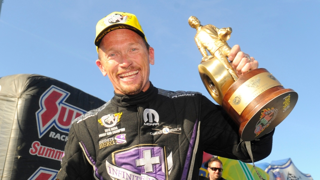Infinite Hero Foundation Funny Car pilot Jack Beckman celebrates with the Wally after winning the NHRA Four-Wide Nationals