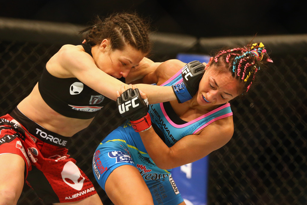 Joanna Jedrzejczyk fights with Carla Esparza in the Women's Strawweight bout during the UFC 185
