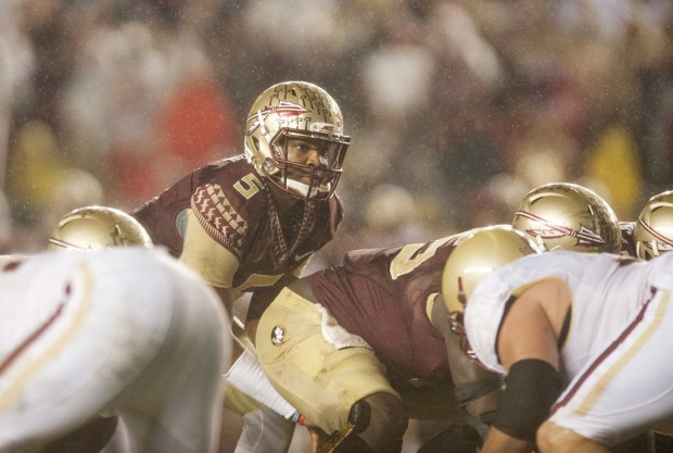 Former Florida State Seminoles quarterback Jameis Winston waits for the snap against the Boston College Eagles in the rain