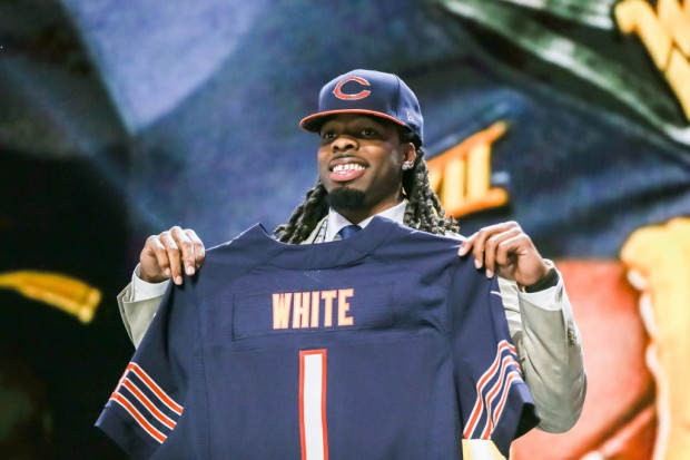 Former West Virginia Mountaineers wide receiver Kevin White holds up a jersey after being drafted in the 2015 NFL Draft
