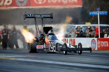 Top Fuel pilot Larry Dixon racing earlier in the season in Pomona