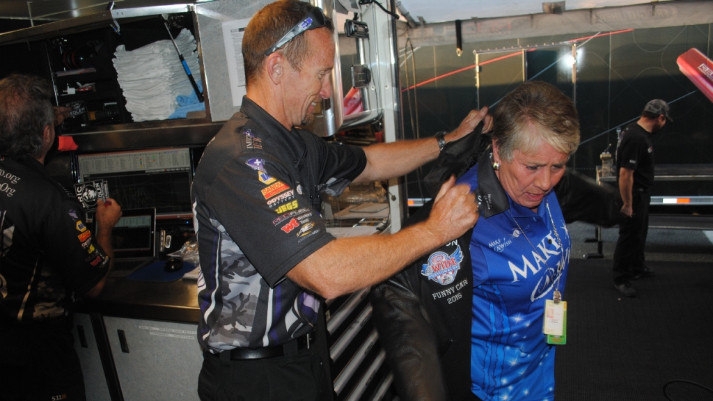 Infinite Hero Foundation Funny Car pilot Jack Beckman presents sponsor Terry Chandler with a winner's jacket from his win at the NHRA Four-Wide Nationals following qualifying on Saturday, June 6, 2015 at the Toyota NHRA Summernationals at Old Bridge Township Raceway Park