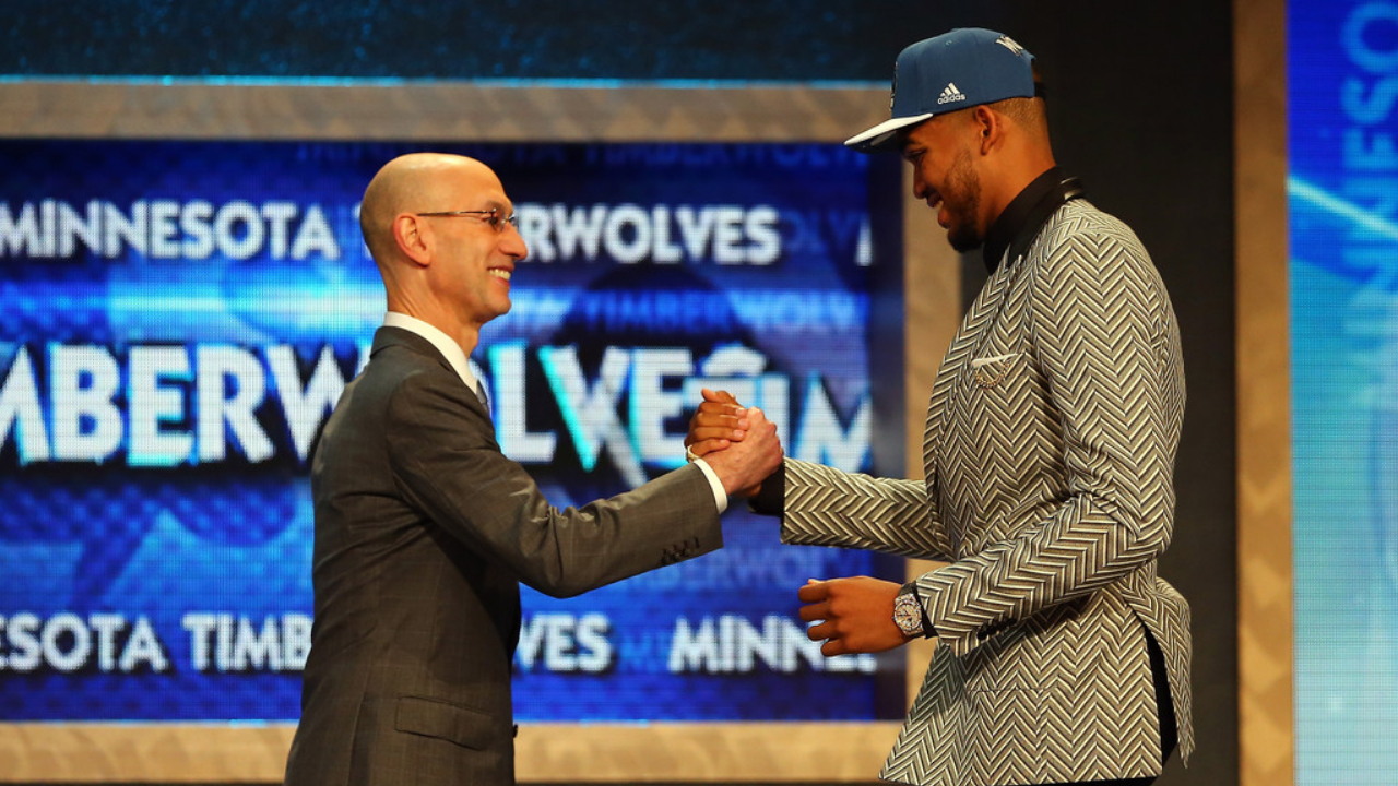 Minnesota Timberwolves center Karl-Anthony Towns celebrates with NBA Commissioner Adam Silver after being drafted with the No. 1 overall pick in the 2015 NBA Draft