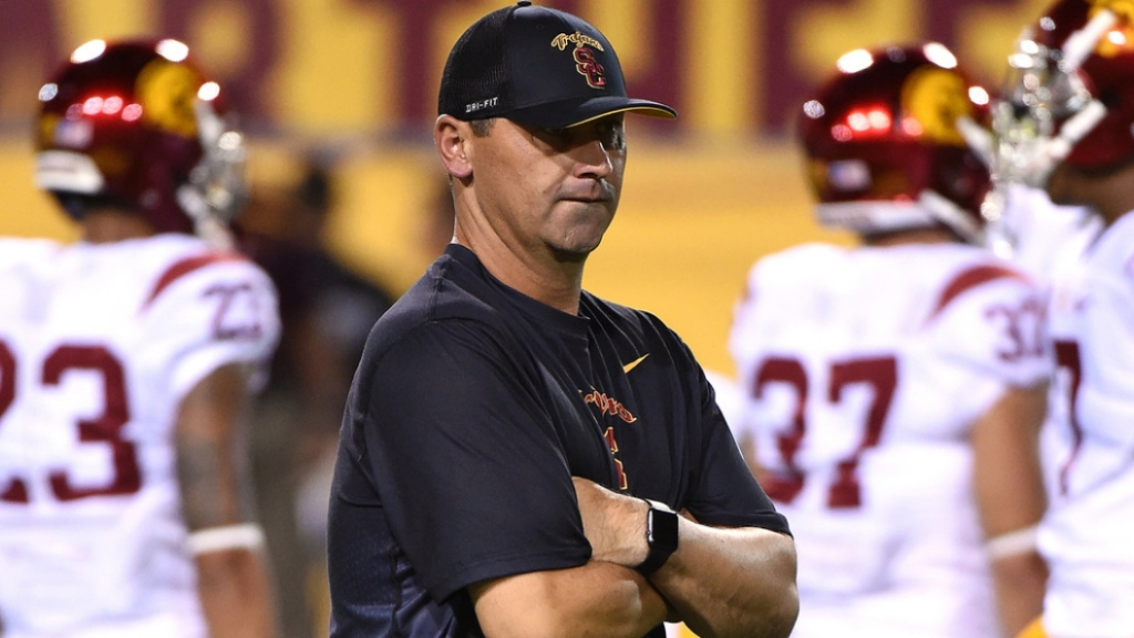 Former USC Trojans head coach Steve Sarkisian watches warm ups prior to a game against the Arizona State Sun Devils