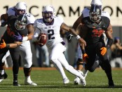 TCU Horned Frogs quarterback Trevone Boykin scrambles against the Oklahoma State Cowboys