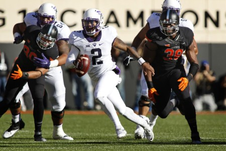 TCU Horned Frogs quarterback Trevone Boykin scrambles against the Oklahoma State Cowboys