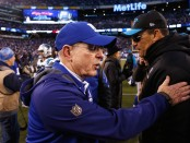 New York Giants head coach Tom Coughlin is seen here talking to Carolina Panthers head coach Ron Rivera after a game (Getty Images)