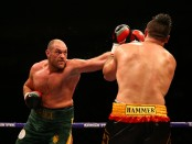 Tyson Fury fighting Christian Hammer at the O2 Arena in England