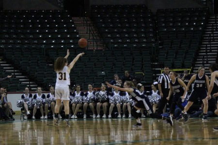 Danielle Griffith shooting a three-pointer (Photo by John Marshall)