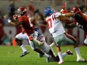 Former Ole Miss defensive end Robert Nkemdiche tackles Alabama Crimson Tide running back Kenyan Drake