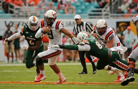 Al-Quadin Muhammad tries to tackle Virginia Tech's Brenden Motley (Getty Images)