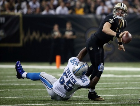Stephen Tulloch tackling New Orleans Saints quarterback Drew Brees (Getty Images)