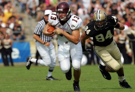 Dan LeFevour being chased by Purdue's Ryan Kerrigan (Getty Images)