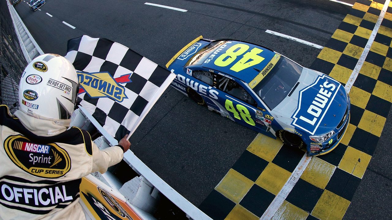 Lowe's Chevrolet driver Jimmie Johnson crosses the finish line to win the NASCAR Sprint Cup Series Goody's Fast Relief 500