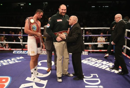 Boxer Tyson Fury with the WBO Heavyweight Championship at the Cooper Box Arena