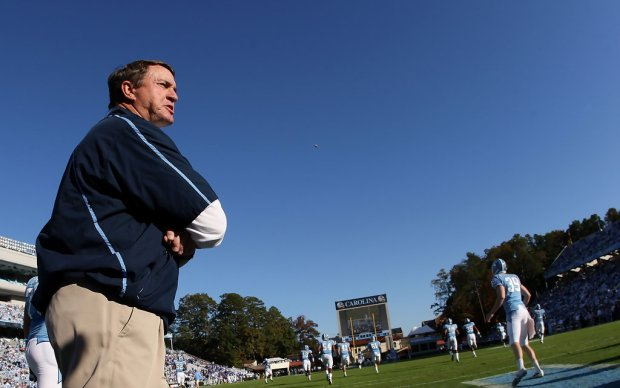 Former North Carolina Tar Heels Head Coach Butch Davis yells to his team during warm ups against the Duke Blue Devils