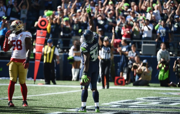 Former Seattle Seahawks running back Christine Michael scores a touchdown against the San Francisco 49ers