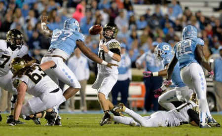 Jalen Dalton is seen here attempting to sack Wake Forest quarterback John Wolford (Getty Images)