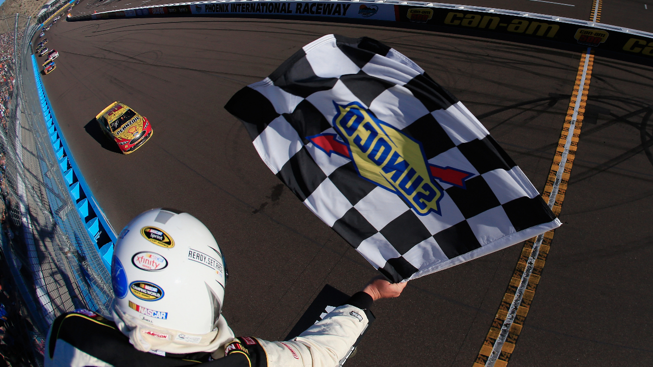 Shell Pennzoil Ford driver Joey Logano takes the checkered flag to win the NASCAR Sprint Cup Series Can-Am 500