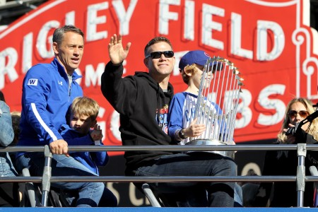 Theo Epstein is seen here with the World Series Trophy (Getty Images)