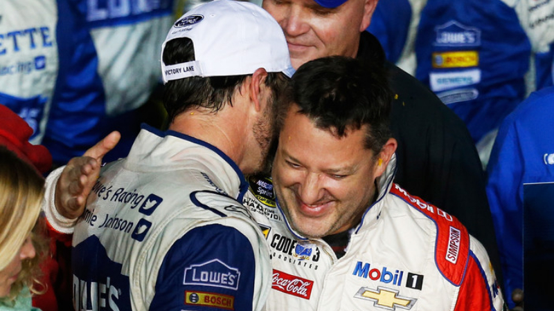 Lowe's Chevrolet driver Jimmie Johnson celebrates in Victory Lane with Always a Racer/Mobil 1 Chevrolet driver Tony Stewart after winning the NASCAR Sprint Cup Series Ford EcoBoost 400 and the 2016 NASCAR Sprint Cup Series Championship