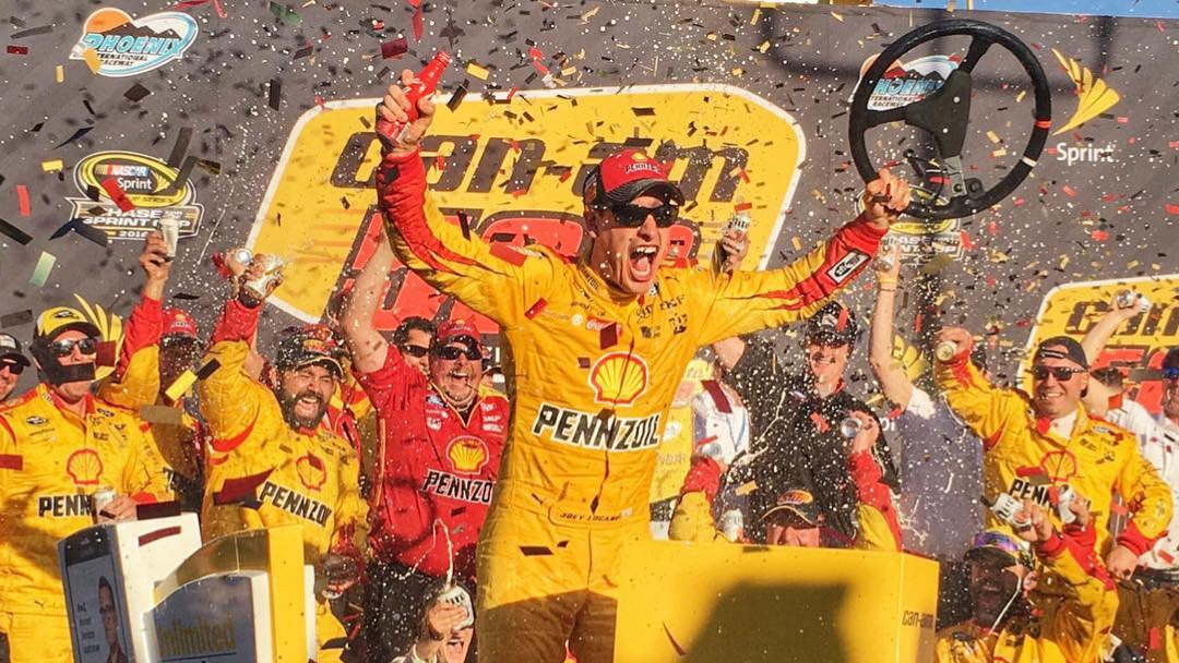 Pennzoil-sponsored driver Joey Logano celebrates his win in the Can-Am 500