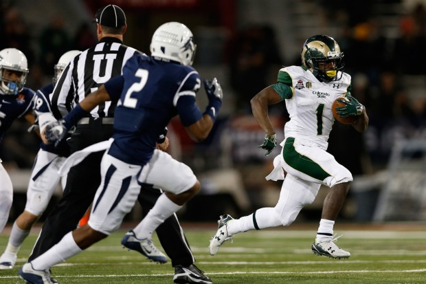 Colorado State Rams running back Dalyn Dawkins rushes with the ball against the Nevada Wolf Pack in the NOVA Home Loans Arizona Bowl