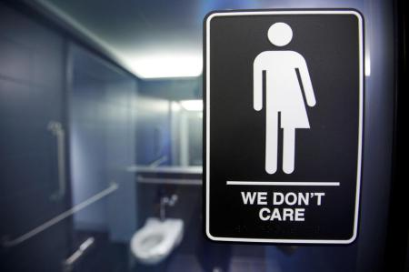 A sign protesting a recent North Carolina law restricting transgender bathroom access adorns the bathroom stalls at the 21C Museum Hotel in Durham, North Carolina May 3, 2016. (REUTERS/Jonathan Drake)