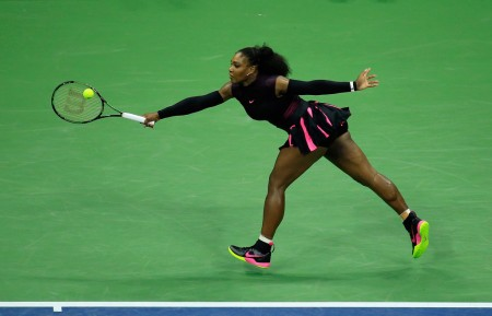 Tennis star Serena Williams returns a shot against Simona Halep of Romania at their Women's Singles Quarterfinals match at the U.S. Open